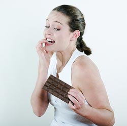 woman with a large bar of chocolate