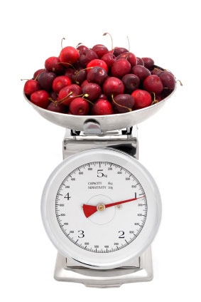 weighing cherries on kitchen scal