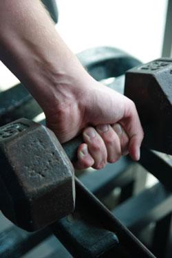 hand holding dumbbell