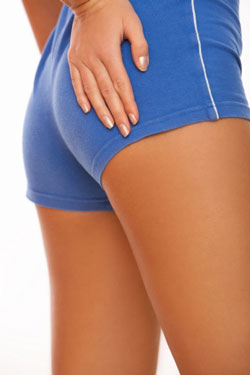 fit woman in blue shorts