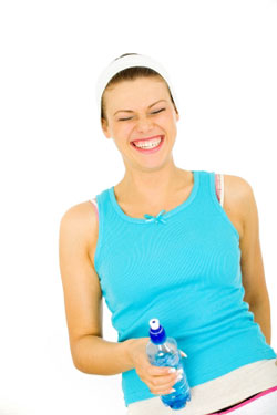 very happy woman with a water bottle