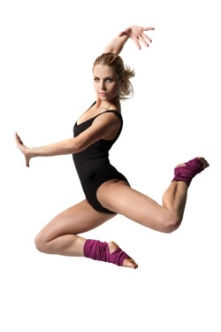 female dancer in black jumping in air