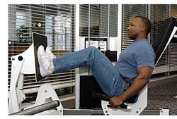 man doing leg press
