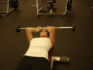 woman doing lying triceps extension second position