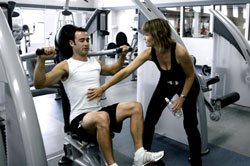man exercising with woman trainer