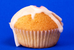 frosted cupcake on blue background