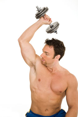man doing tricep extensions with dumbbell