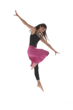 woman in black tights and pink skirt dancing