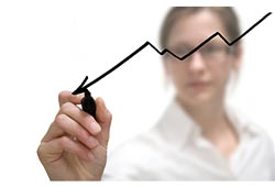 woman marking progress on a graph