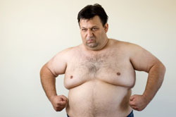 heavy man upset about not being able to lose weight