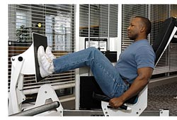 man doing leg press