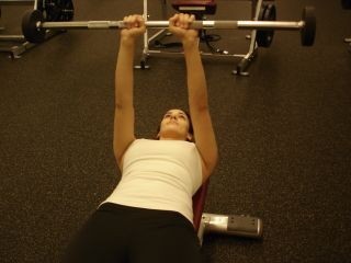 woman doing lying triceps extension starting position