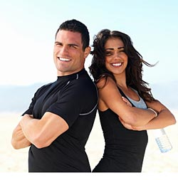 fit couple standing back to back