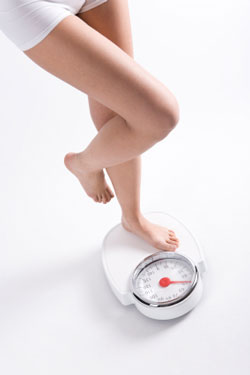 woman on scale weighing herself