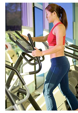 woman on stair stepper machine
